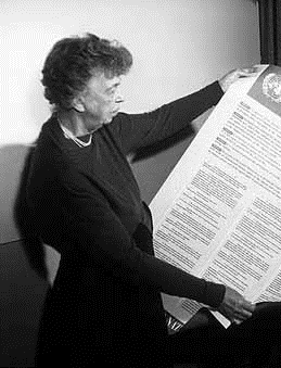 Former U.S. First Lady Eleanor Roosevelt with the United Nations Universal Declaration of Human Rights, 1949.