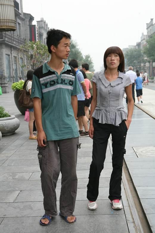 AIDS activist and victim, Liu Ximei, with volunteer Wen Dao. Beijing, July 7, 2012. Photo Credit: Paul J. Mooney.