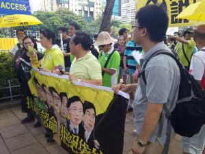 """Albert Ho (2nd from left), Chairman of the Hong Kong Alliance, at the """"The Citizens Against Pseudo-Universal Suffrage"""" march, Hong Kong, June 14, 2015. HRIC photo."""