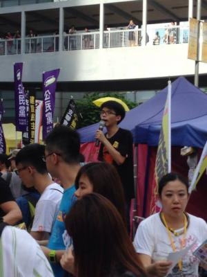 """Joshua Wong, convener of Scholarism, at the """"The Citizens Against Pseudo-Universal Suffrage"""" march, Hong Kong, June 14, 2015. HRIC photo."""