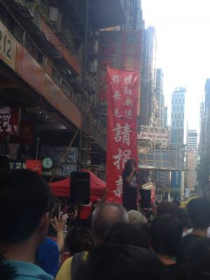 """Leung Kwok-hung, also known as """"Long Hair,"""" of the League of Social Democrats, addresses the crowd during the democracy march organized by Civil Human Rights Front,, Hong Kong, July 1, 2015. HRIC photo."""