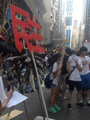 "Sign: ""Democracy,"" during the democracy march organized by Civil Human Rights Front, Hong Kong, July 1, 2015. HRIC photo."