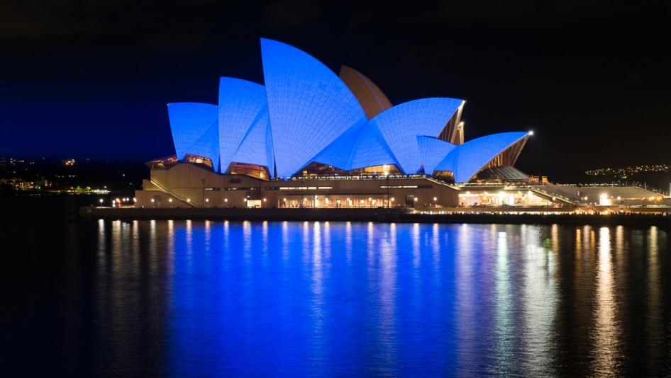 Sydney Opera House illuminated in blue. Sydney, Australia